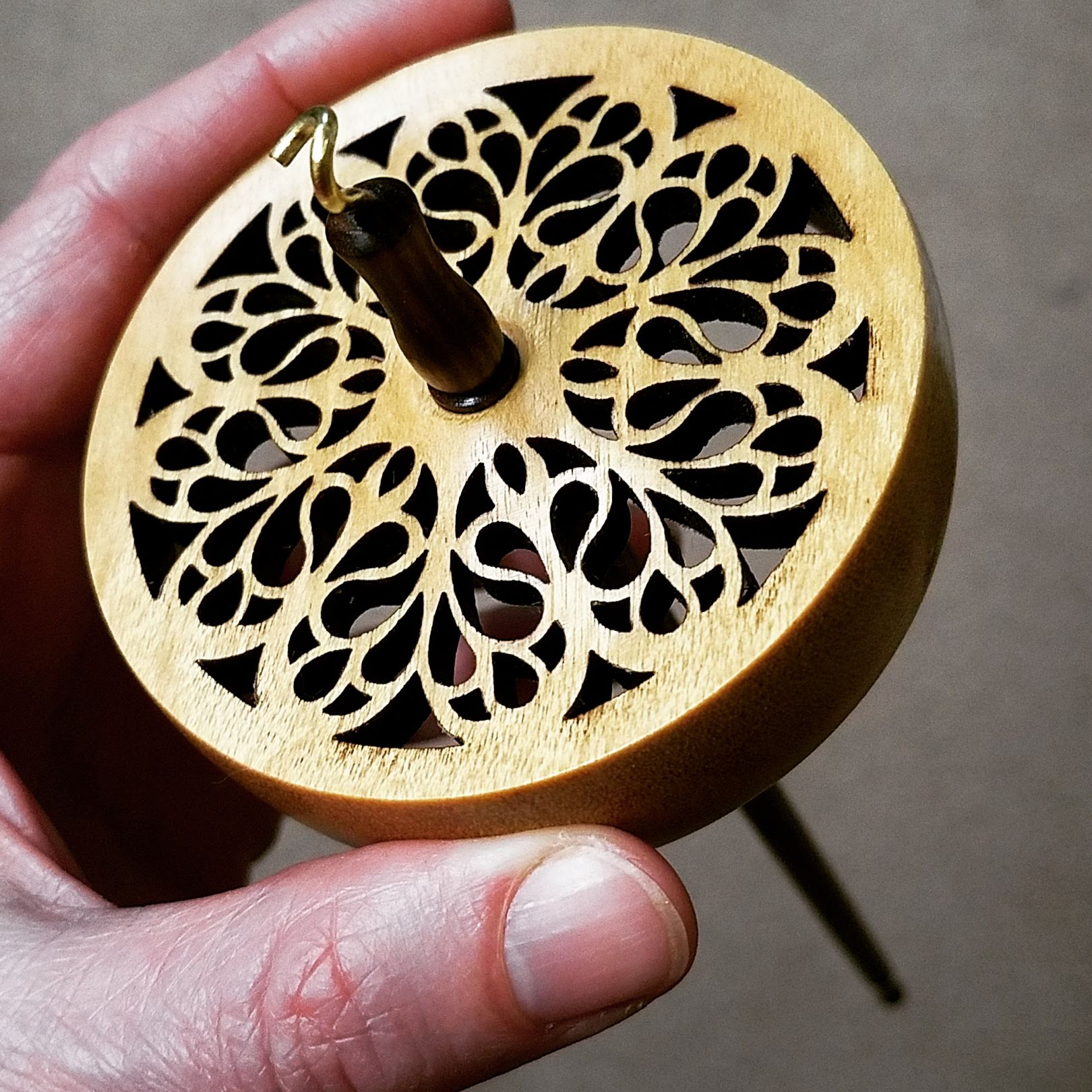 A Spanish Peacock cut out drop spindle
