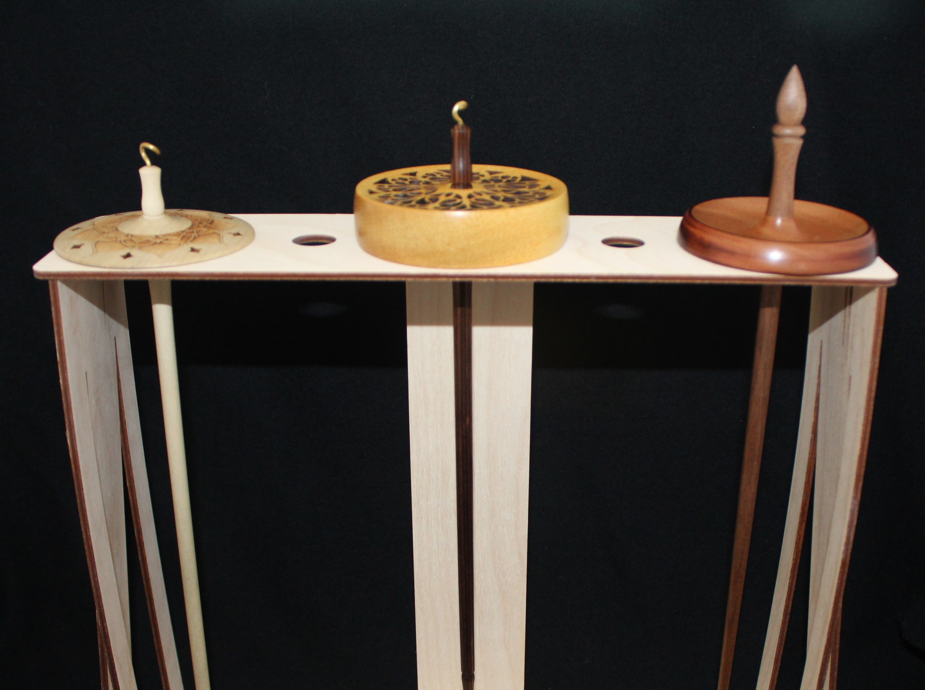 A Spanish Peacock Spindle Storage Stand can hold up to three spindles with wider whorls