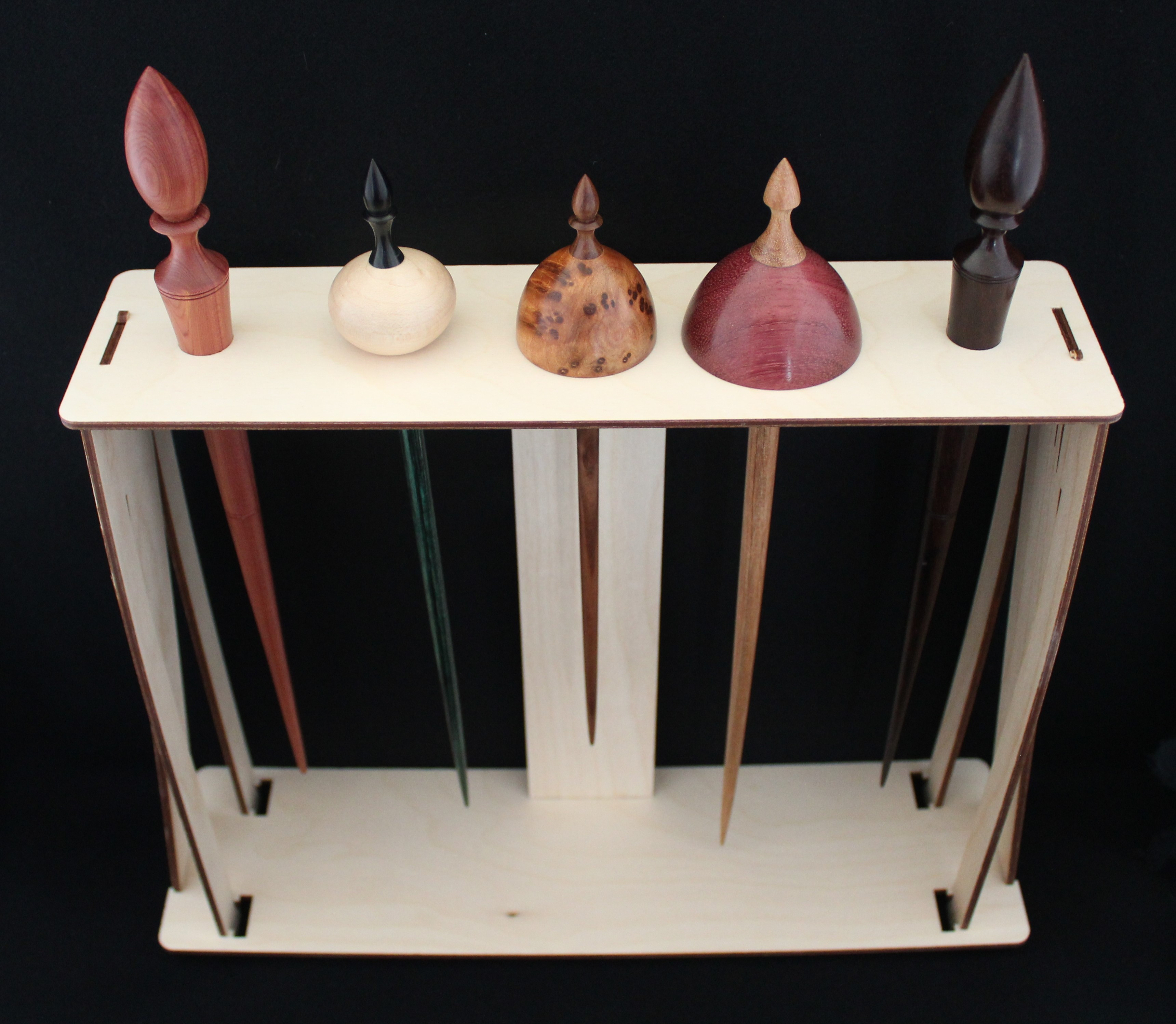 A Spanish Peacock Spindle Storage Stand can hold up to five narrow spindles
