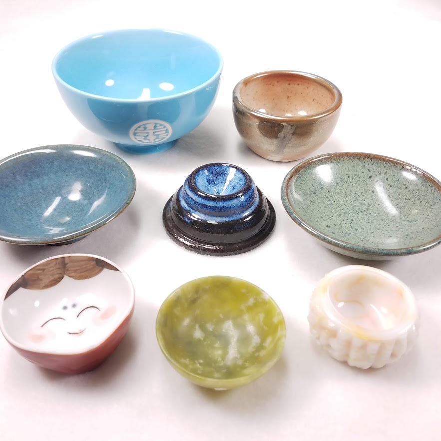 A variety of ceramic, glass, and stone supported spindle bowls