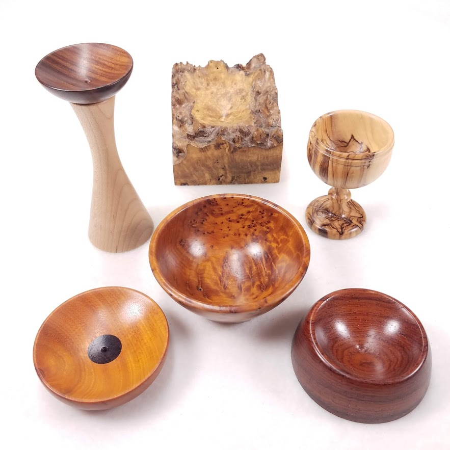 A selection of wooden supported spindle bowls
