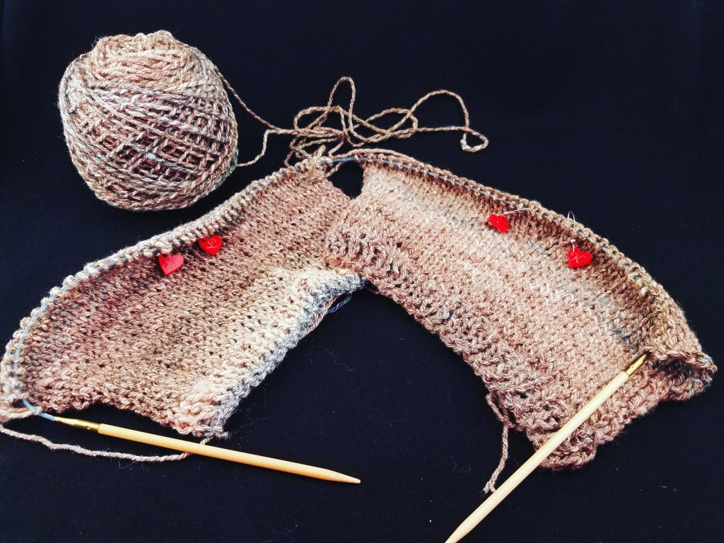One circular knitting needle, two mittens the same size!