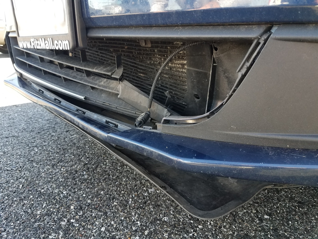 "The ""minor"" damage to my car's front bumper from high speed impact with a standing racoon"