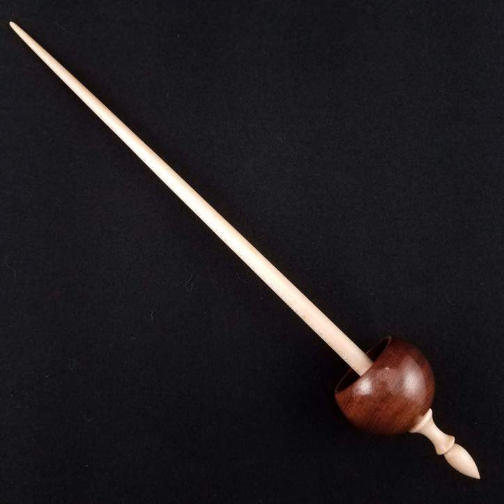 A Spanish Peacock ninja spindle, featuring a Bolivian rosewood whorl on a maple shaft