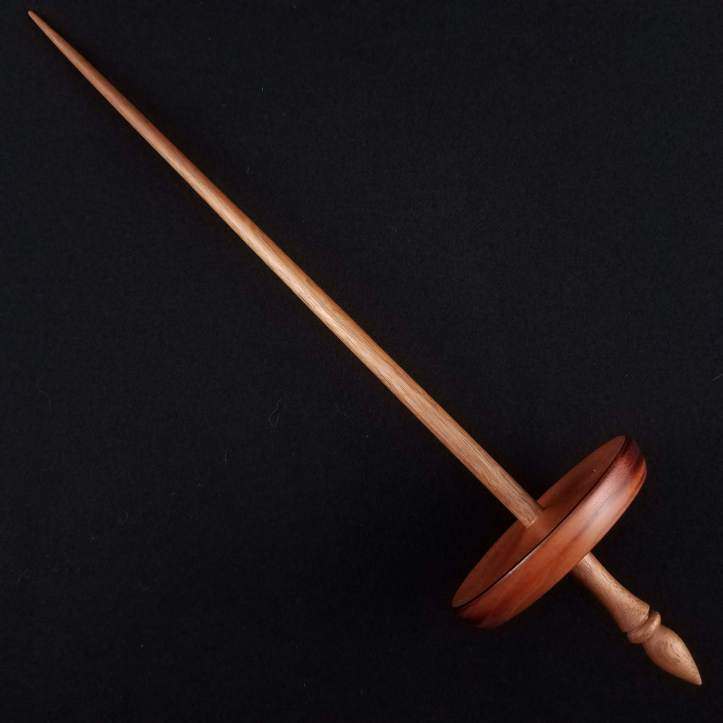 A Spanish Peacock pu yok, featuring a cherry whorl on a walnut shaft