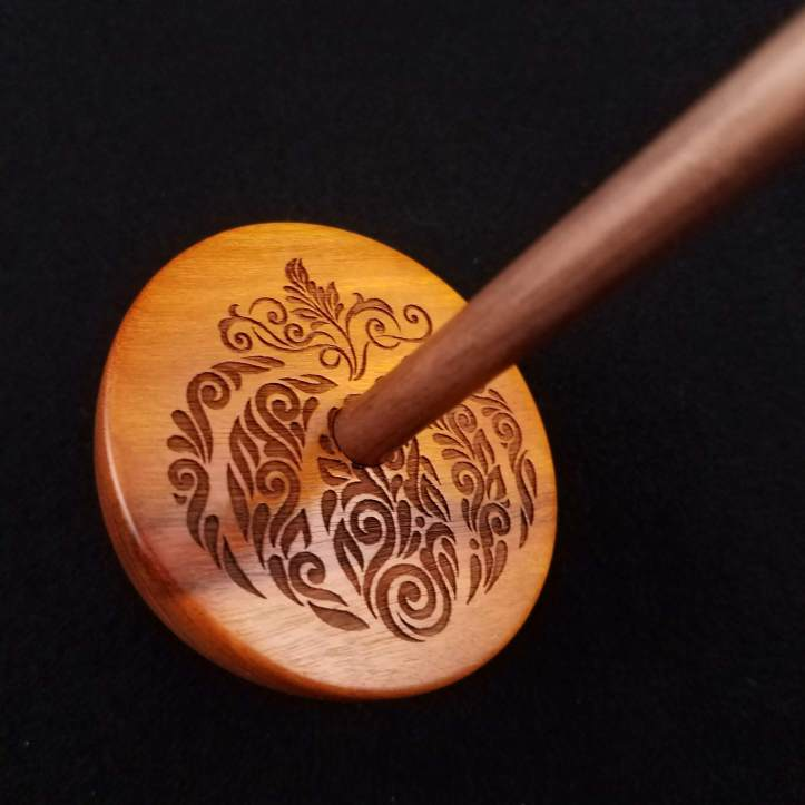 An engraved whorl on a small bottom whorl