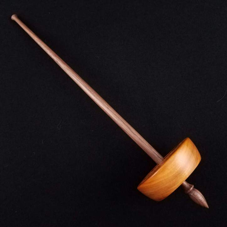 A Spanish Peacock small bottom whorl spindle, featuring a chakte viga whorl on a walnut shaft