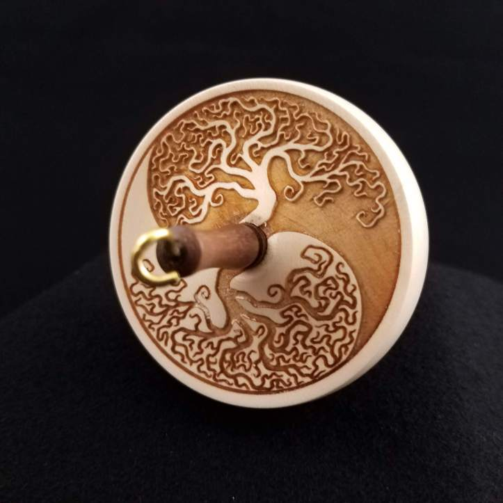 An engraved small top whorl spindle
