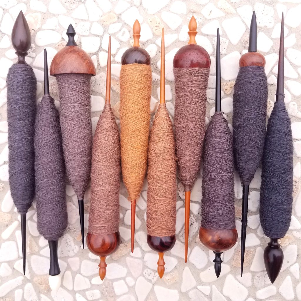 Ten spindles fully dressed in gorgeous fiber!