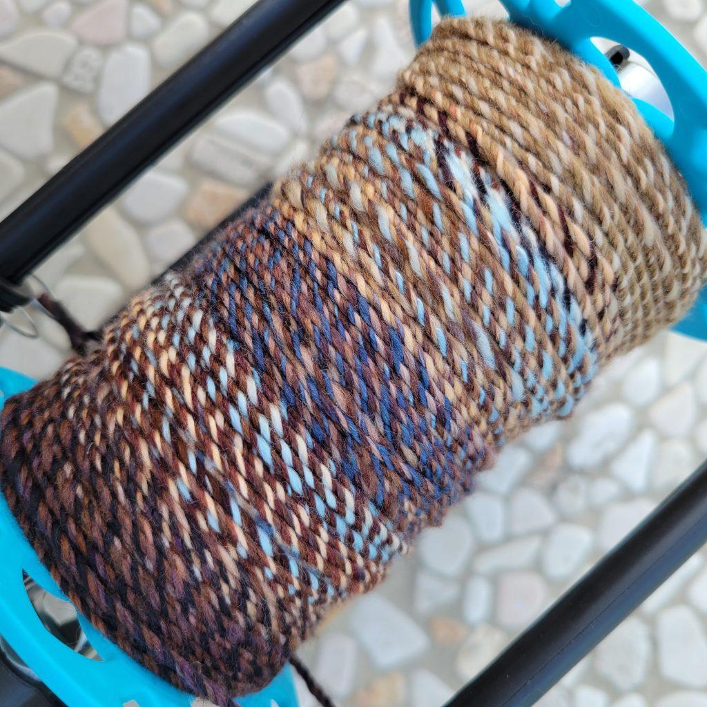 Bobbin shot while plying my fractal yarn