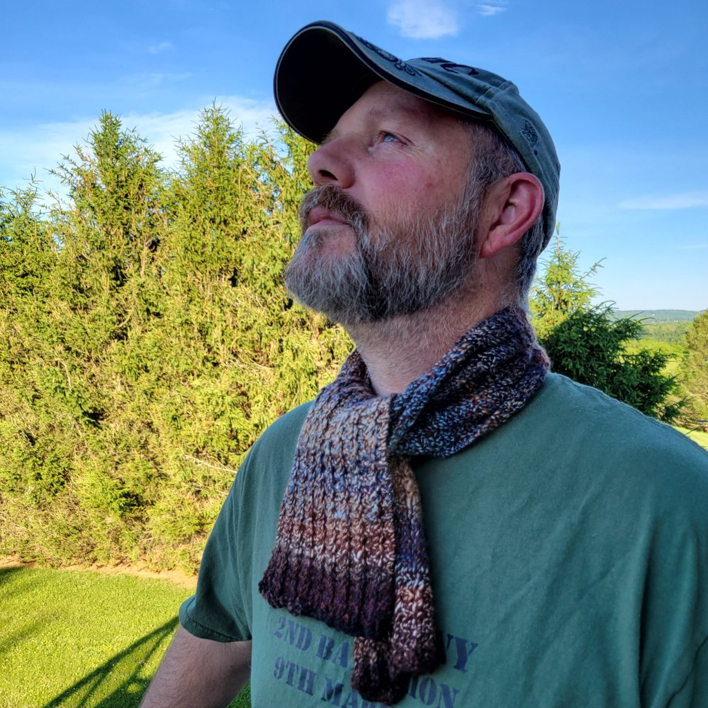 Mike shows off his new scarf