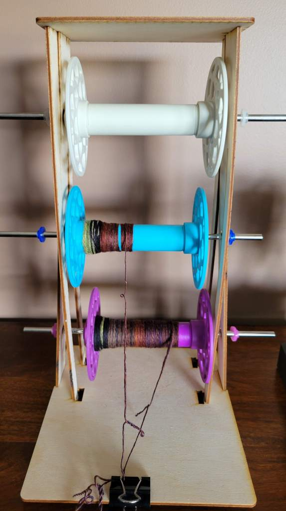 My three bobbins ended up with different lengths of singles yarn, despite my OCD weighing while splitting the fiber