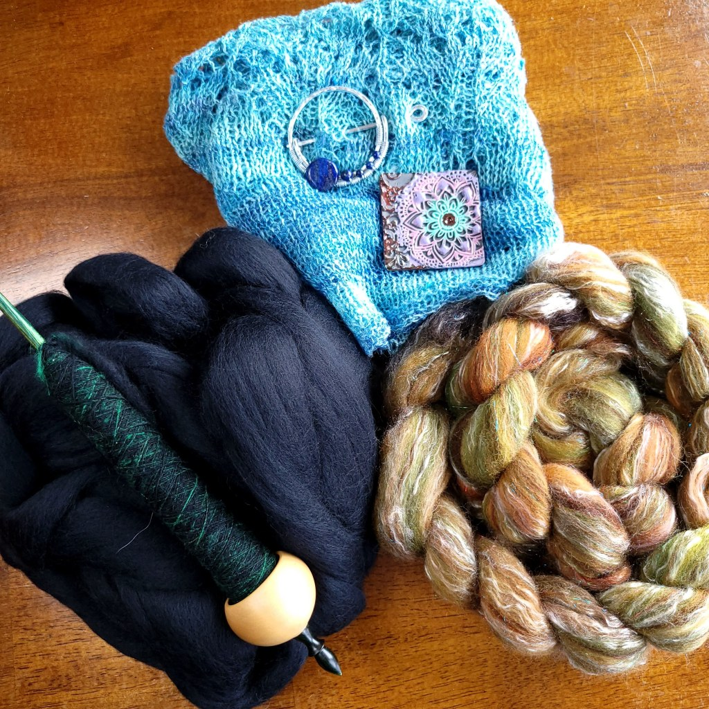 SVFF loot - two shawl pins, a brown and green braid, and straight black merino